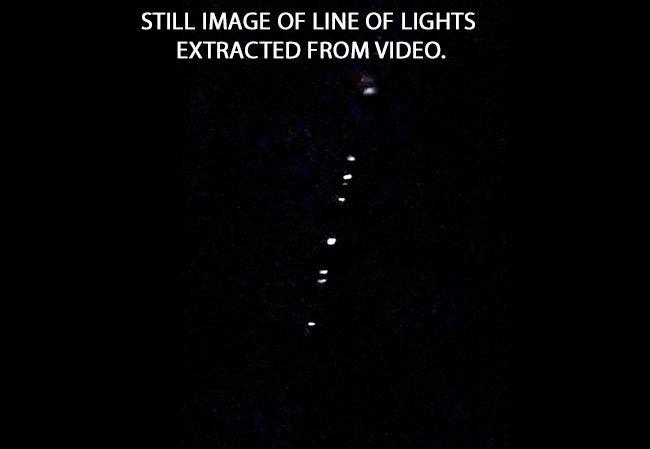 String of Christmas-Like Lights Move Silently Across Sky.