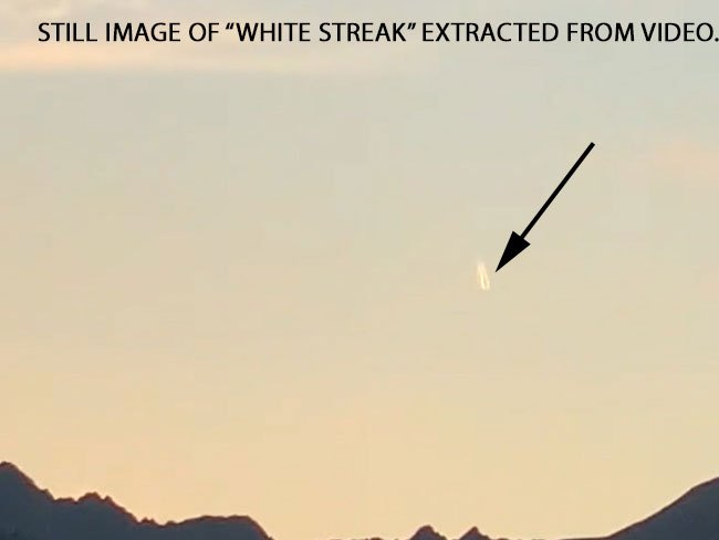 White Streaked Object Seen Moving Towards Mountains.